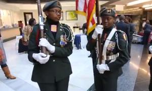 The North Atlanta JROTC Color Guard prepares to present the colors before a Veterans Day event at The Atlanta City Hall building.