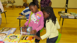 Dunbar Elementary students select new books donated by Books for Keeps for their personal home library.    Photo Credit: Kimberly Willis Green, APS
