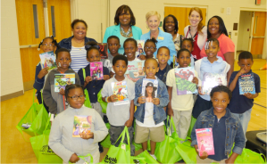 Dunbar Elementary School Principal Karen Brown-Collier (second from left) and Georgia first lady Sandra Deal (center) are pictured with Dunbar Elementary teachers and Books for Keeps Executive Director Leslie Hale (second from right), as second grade students show off their new books     Photo Credit: Kimberly Willis Green, APS