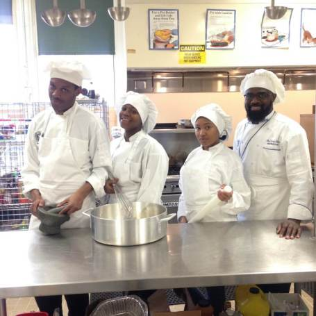 (From L-R) Crim High School Culinary Arts students Darryl Mobley, Rickell Etheridge, Latisha Grant and Crim High School Culinary Art Career Pathway Instructor Chef Larry Alford