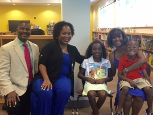 Author Lauryn Marie Burks featured with Mary Lin Principal Sharyn Briscoe (second, left) and Burks' family.