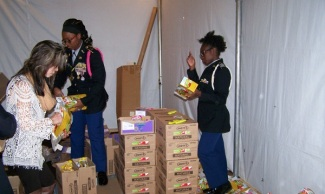 "Cadets in the JROTC unit of Coretta Scott King Young Women's Leadership Academy served as volunteers in the USO's ""Operation Care Package""."