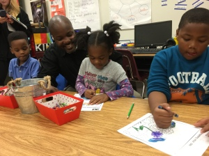 L.O. Kimberly Elementary School Principal Joseph Salley looks on as kindergarten students color images of kindness sheets provided by KIND Snacks.