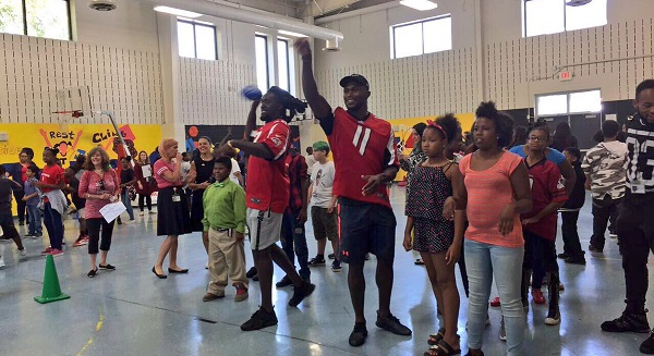 Campbell and Jones play catch at Toomer ES