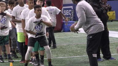 Nearly 200 students from seven Atlanta Public Schools middle schools took part in this year's SEC Youth Football Clinic at Mercedes-Benz Stadium. The annual event is coordinated by USA Football.