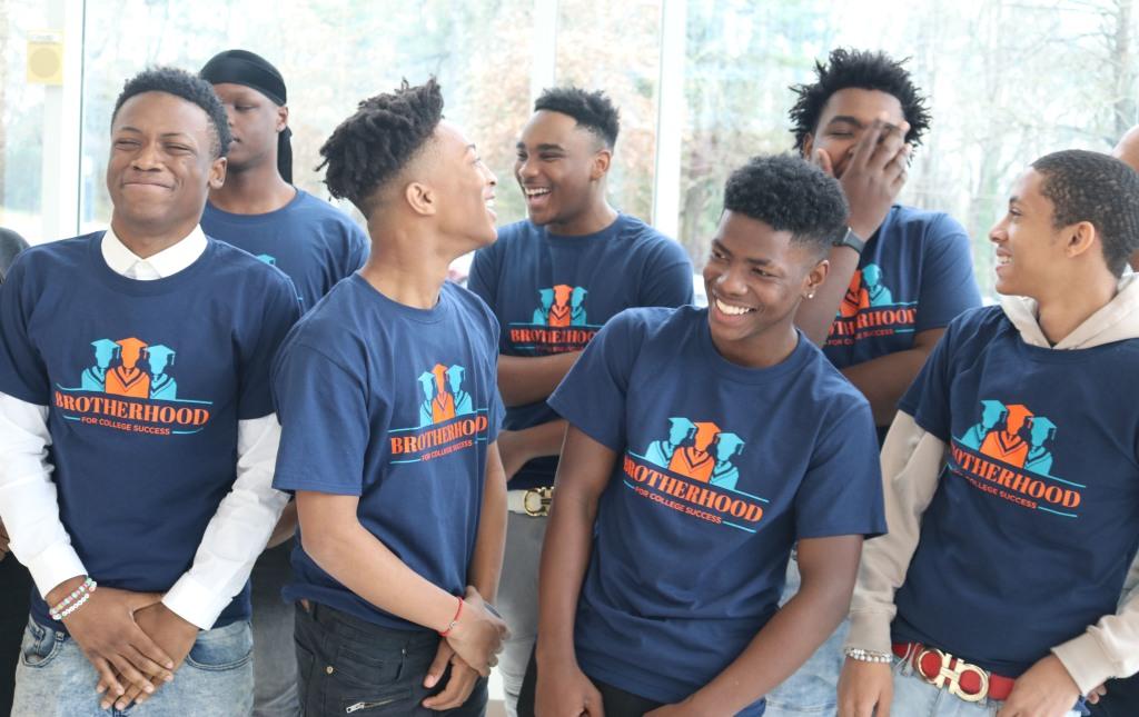 black male students smiling, brotherhood